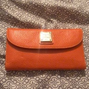Dooney & Bourke wallet. NWT. Never used. Orange.